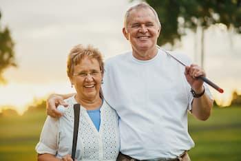 Senior Couple Golfing